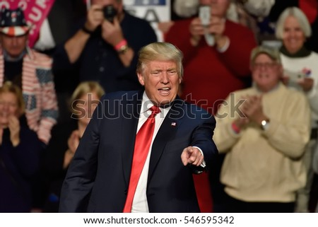 "HERSHEY, PA - DECEMBER 15, 2016: President-Elect Donald Trump points straight toward the crowd as he concludes his speech at a ""Thank You Tour"" rally held at the Giant Center."