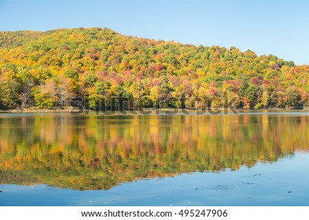 Hertel Lake in Quebec, Canada, with Autumn colors