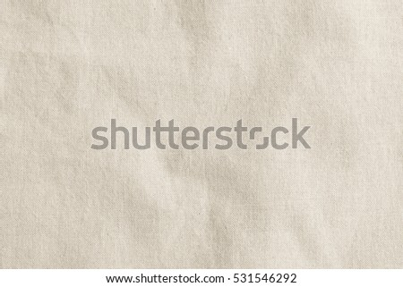 Hessian sackcloth woven texture pattern background in light cream sepia tan beige color earth tone: Eco friendly raw organic cloth fabric textile backdrop: Bag rope cotton thread detail burlap canvas