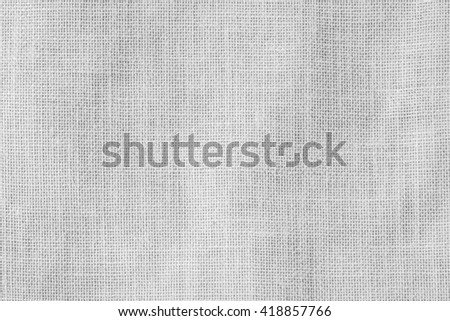 Hessian sackcloth woven texture pattern background in light white grey gray color tone: Eco friendly raw organic flax cloth fabric textile backdrop: Bag rope thread detailed textured burlap canvas - stock photo