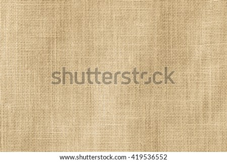 Hessian sackcloth woven texture pattern background in light yellow gold cream color tone: Eco friendly raw organic flax cloth fabric textile backdrop: Bag rope thread detailed textured burlap canvas - stock photo