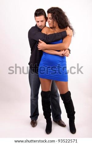 heterosexual couple embraced in tender position - stock photo