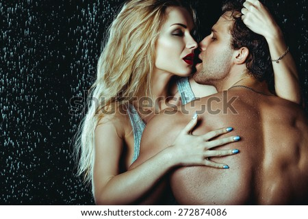 Heterosexual Couple of Attractive Man And Woman Sexualy Wet Posing Under Water - stock photo