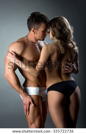 Heterosexual couple tenderly caressing each other - stock photo