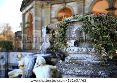 HEVER CASTLE AND GARDENS, KENT,  UK - MARCH 10, 2014: Grot and waterfalls in park. 13th century castle with Tudor manor house and 250 acre of park.  - stock photo