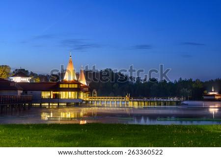 HEVIZ, HUNGARY - APRIL 26, 2014: Building of  Heviz Lake Spa. Heviz lake is the second largest thermal lake in the world - stock photo