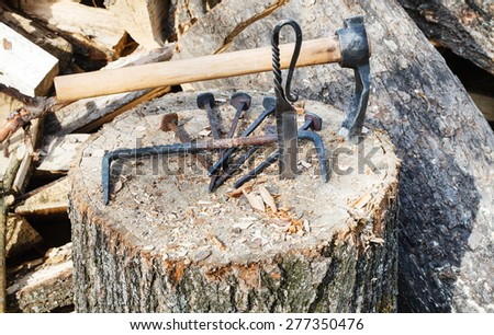 hew ax and forged hardware on wooden deck near village smithy