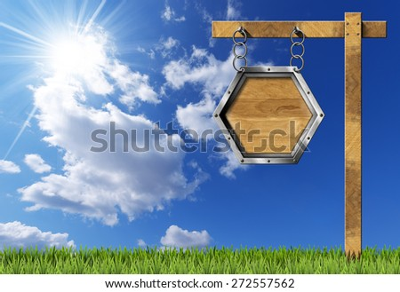 Hexagonal Sign with Chain and Pole. Empty hexagonal wooden sign with metallic frame hanging with metal chain on a wooden pole, on blue sky with clouds, sun rays and green grass - stock photo