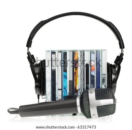 HI-Fi headphones on stack of CDs with microphone on white background