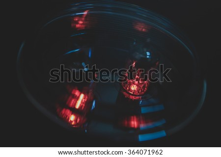 hi-fi vacuum tubes amplifier, electronic device amplifier with glowing bulb diode lamp for sound reproduction over dark background,   - stock photo