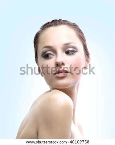 Hi key portrait of a beautiful woman getting ready for the spa treatment - stock photo