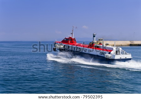 Hi-speed boat leaves the port - stock photo