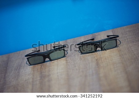 hi technology modern movie 3d glasses with blue background - stock photo