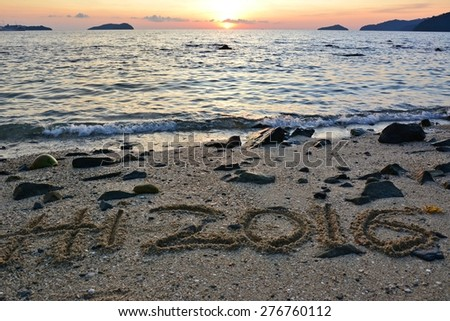 Hi 2016 written on sandy beach during sunset. New Year concept for background - stock photo
