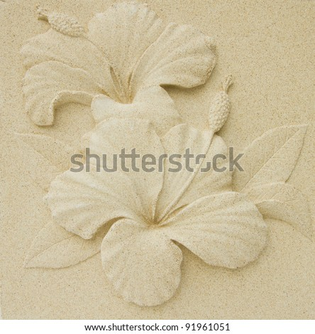 Hibiscus flower pattern on the walls, plaster, natural color. - stock photo