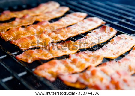 Hickory Smoked Bacon on the Grill - stock photo