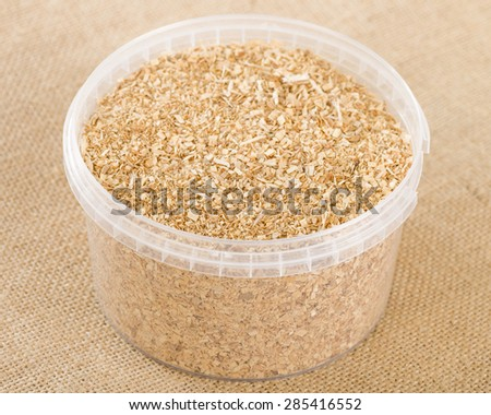 Hickory Wood Chips - Finely ground hickory wood chips used for smoking in a plastic round container.  - stock photo