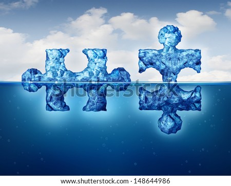 Hidden connections team business concept as a symbol of private deal making and building a secret network under the radar as two icebergs in the arctic floating on the ocean with a portion exposed. - stock photo