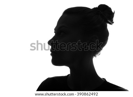 Hidden face in the shadow.Female silhouette. - stock photo