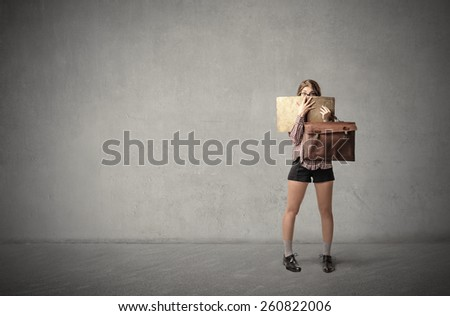 Hiding behind the suitcases  - stock photo