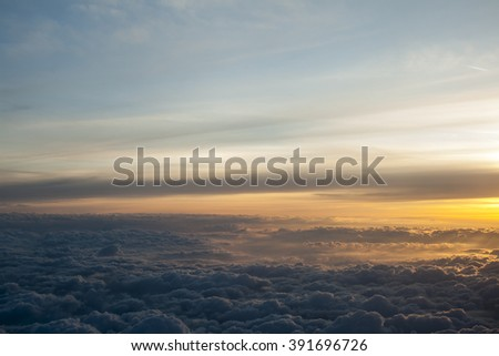 High above the clouds with beautiful sunset light - stock photo