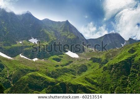 High alpine mountain peaks - stock photo