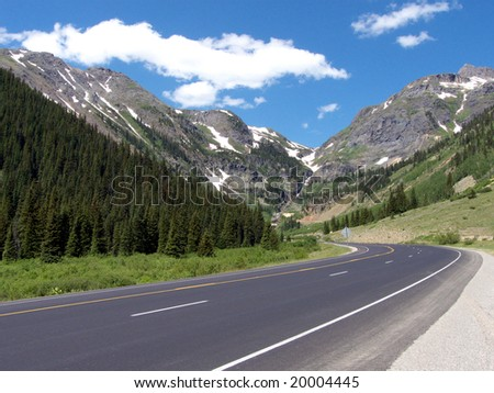 High altitude highway rounding the bend in the Rocky Mountains