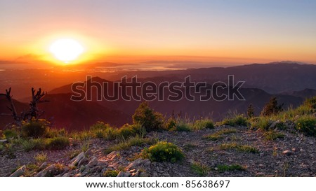High Altitude Sunset over Salt Lake City, Utah from the summit of Gobblers know in the Olympus Wilderness.
