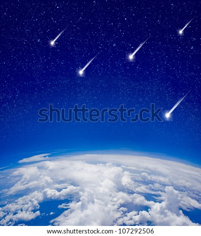 High altitude view between sky and space with meteors - stock photo