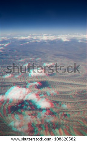 High altitude view of clouds in 3D. View anaglyph with red/cyan glasses. These are over the American mid-west. - stock photo