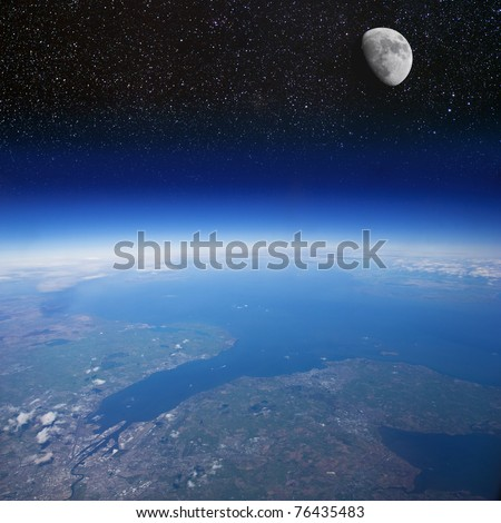 High altitude view of the Earth and the Moon (the city in the foreground is Belfast in Northern Ireland) - stock photo