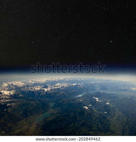 High altitude view of the Earth in space. The Alps. - stock photo