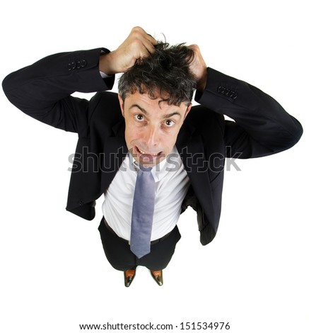 High angle fun portrait of a mature business man tearing out his hair in desperation and frustration isolated on white - stock photo
