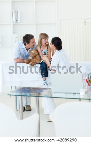High angle of a doctor giving medecine to a little girl during a visit - stock photo