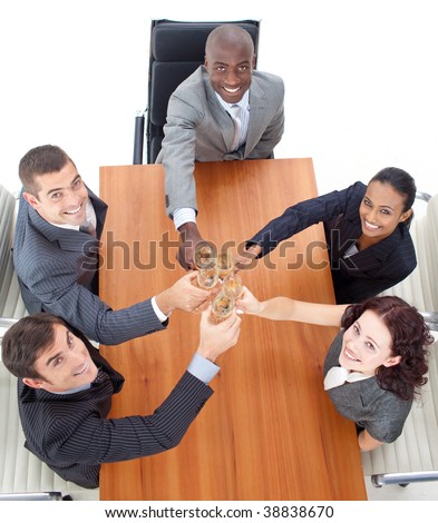 High angle of business people celebrating a success with champagne in a meeting - stock photo