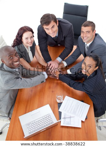 High angle of business people with hands together  in a meeting - stock photo