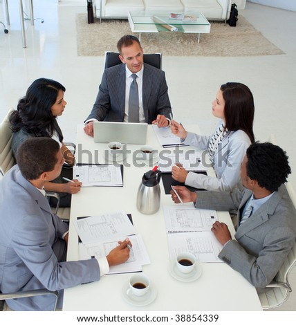 High angle of Multi-ethnic business people discussing in office a plan - stock photo