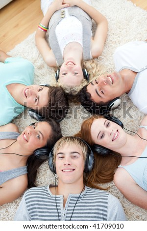 High angle of young Teenagers listening to music - stock photo