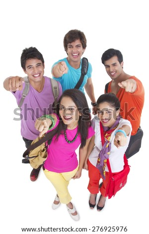 High angle portrait of university students pointing at you over white background