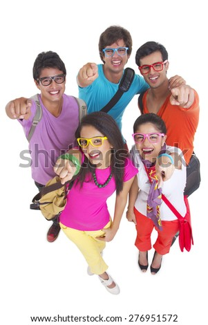 High angle portrait of university students wearing glasses while pointing at you over white background