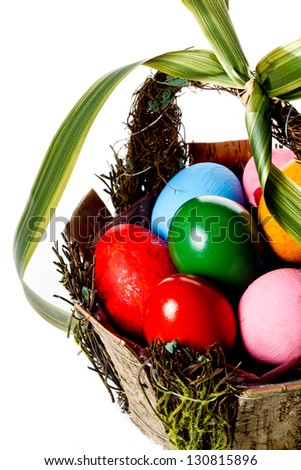 High angle shot of a decorative basket full of colorful Easter eggs - stock photo
