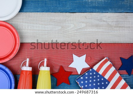 High angle shot of a patriotic red, white and blue picnic table. Horizontal format with copy space. Perfect for American Holidays: 4th of July, Memorial Day or Veterans Day. - stock photo