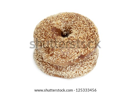 High angle shot of two bagels filled with sesame seeds isolated in white background