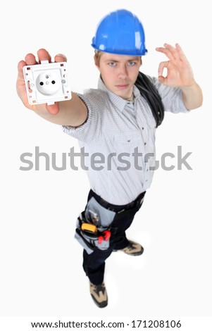high angle shot of young electrician showing socket - stock photo