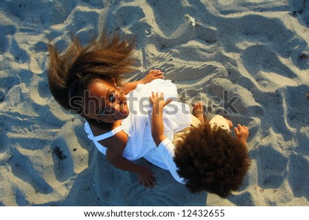 High angle shot taken from above two little children at the beach - stock photo