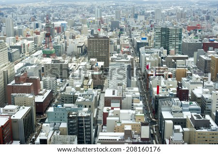 High angle view from the JR Tower of snow on the rooftops of Sapporo, Japan in winter - stock photo