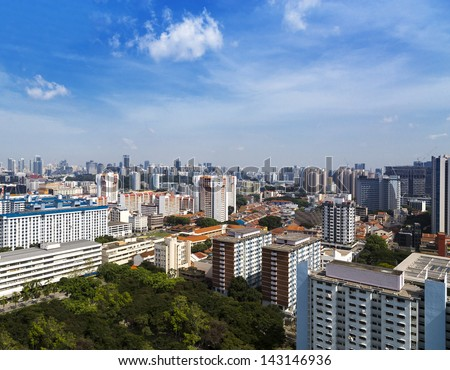 High angle view of a cluster of colourful flats in residential District next to a park- Singapore - stock photo