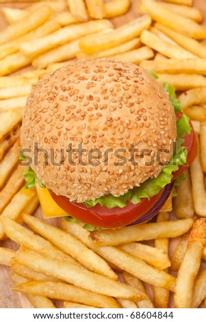 high angle view of big tasty  cheeseburger and french fries - stock photo