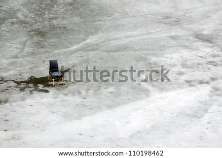 High angle view of black chair on melting ice