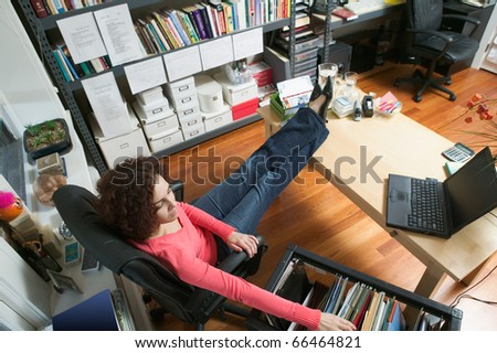 High angle view of businesswoman in office - stock photo